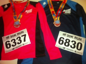 2 more finisher's medals for our wall... and some pretty sweet race shirts!  'Cause that's why we really do this...